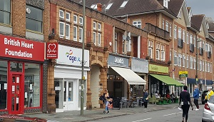 View down Horley High Street showing shops